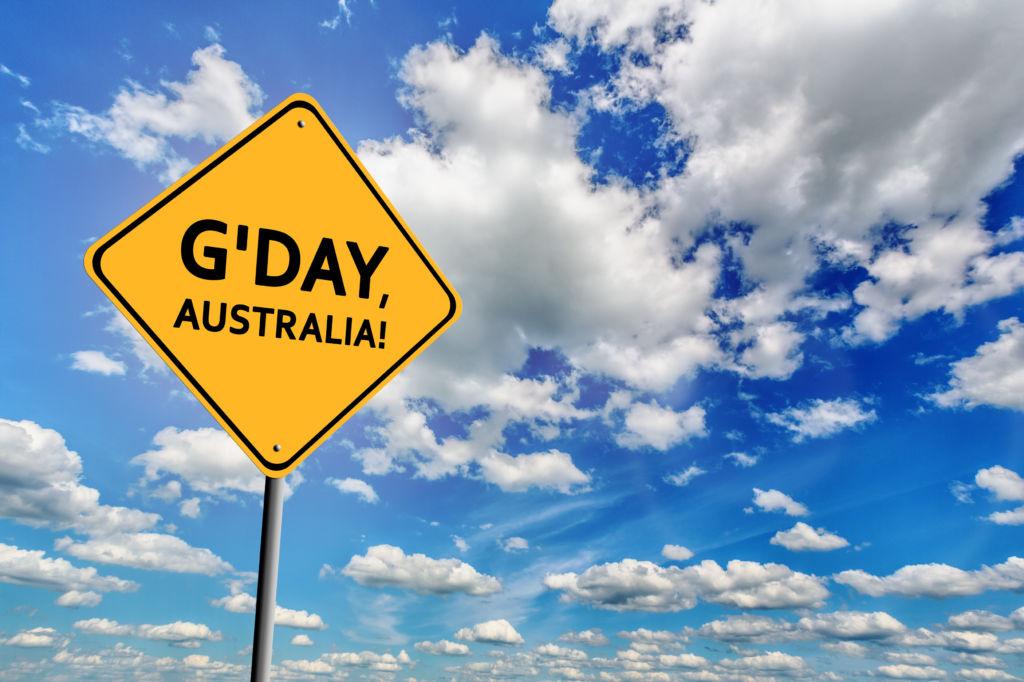 Señal  G'day, Australia con texto en negro y fondo amarillo fondo azul expresiones palabras australianas